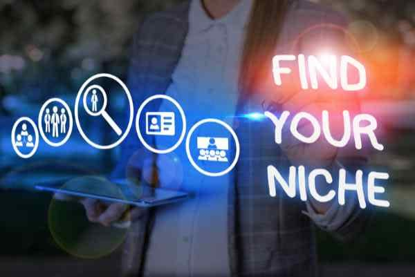 Conceptual hand writing showing Find Your Niche. Man holding a tablet with images for search, email, presentations, business and social media