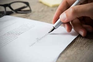 Man signing a website contract