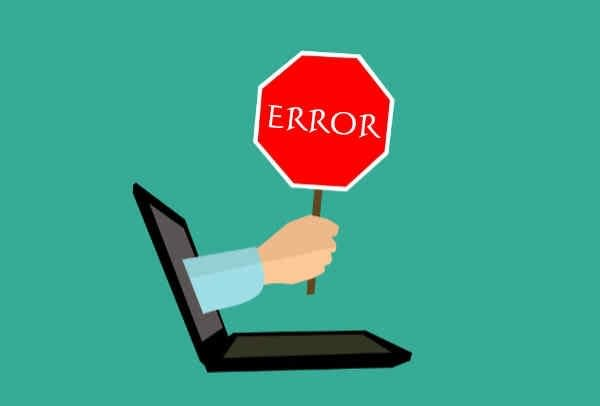 Error graphic with a stop sign coming out of a computer screen.