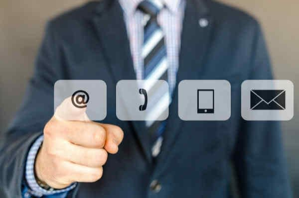 Man pushing a contact button on a screen.